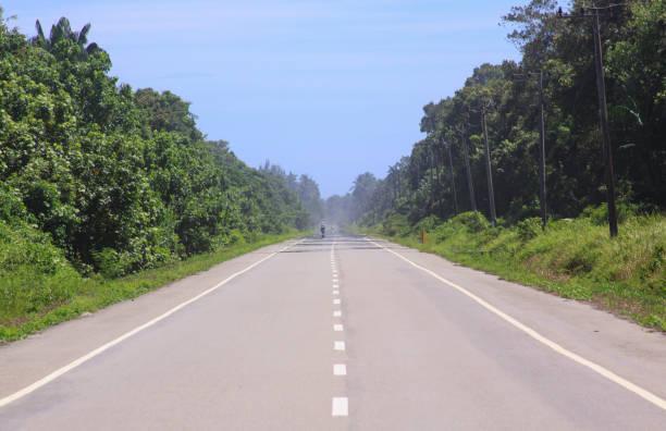Straight road in Aceh, Sumatra, Indonesia stock photo