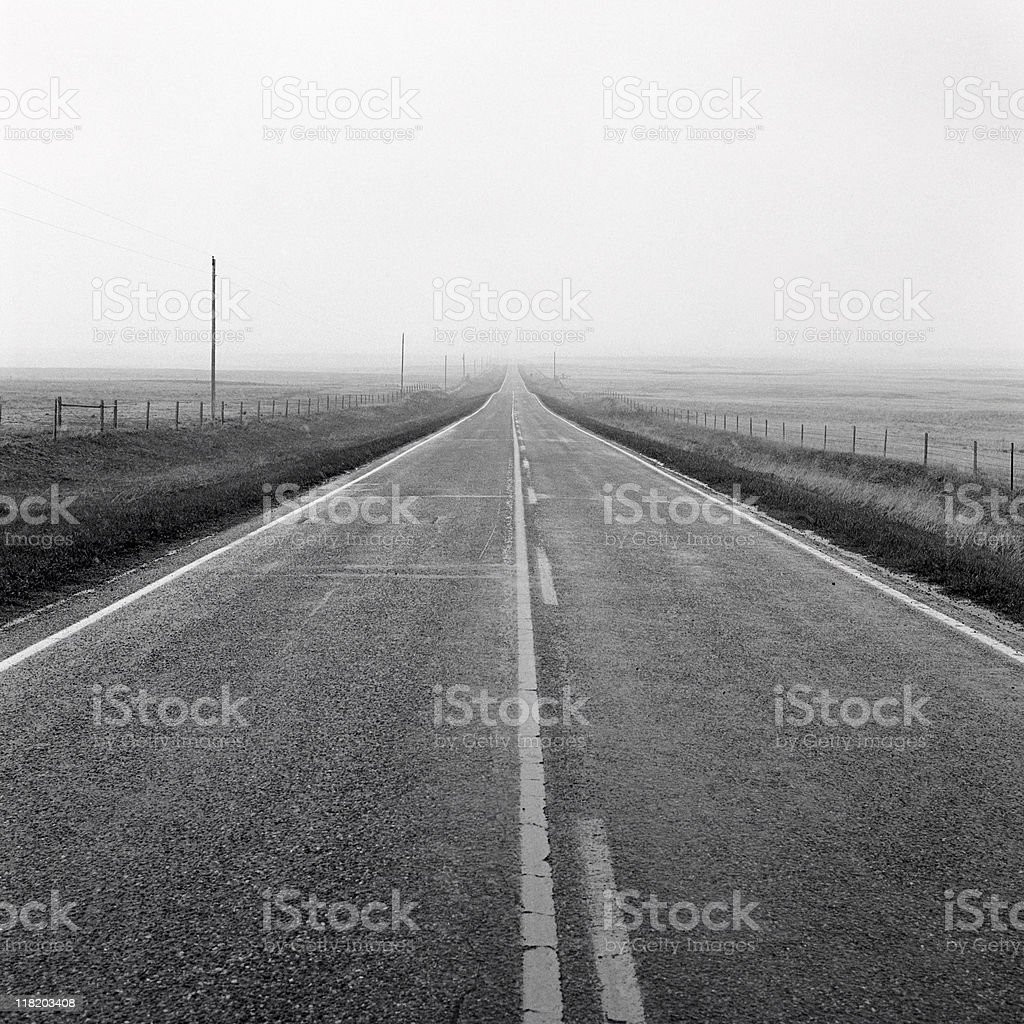 Straight road in bad weather royalty-free stock photo