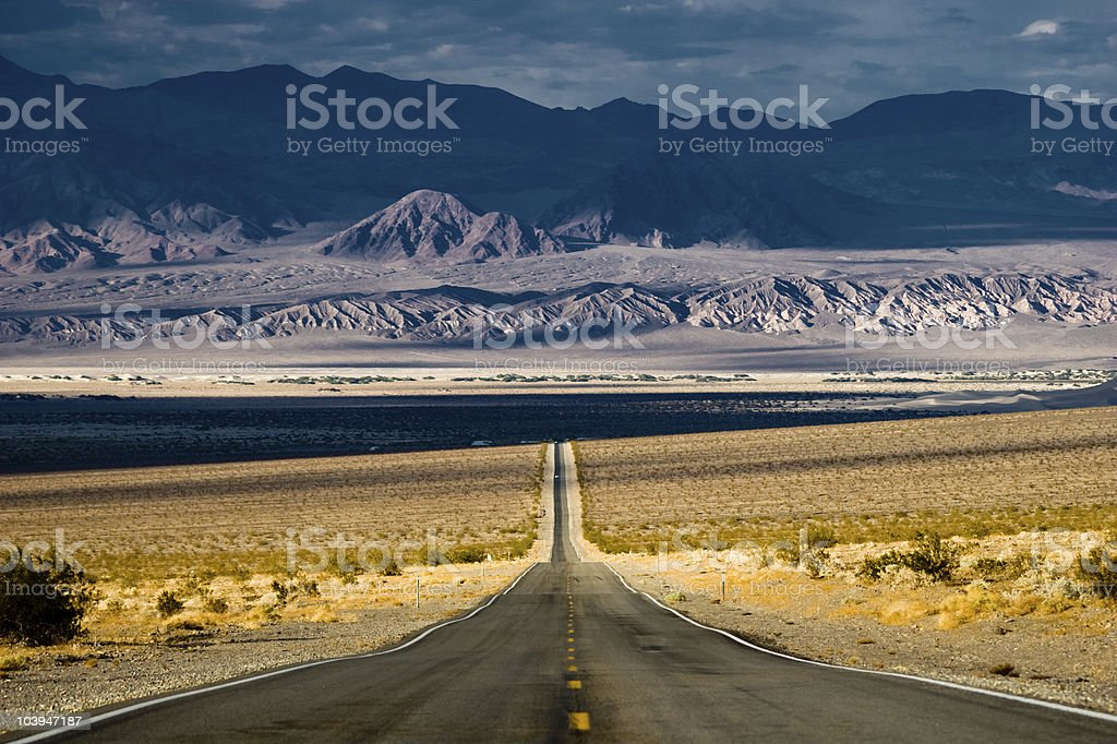Straight road in the desert of Death Valley stock photo