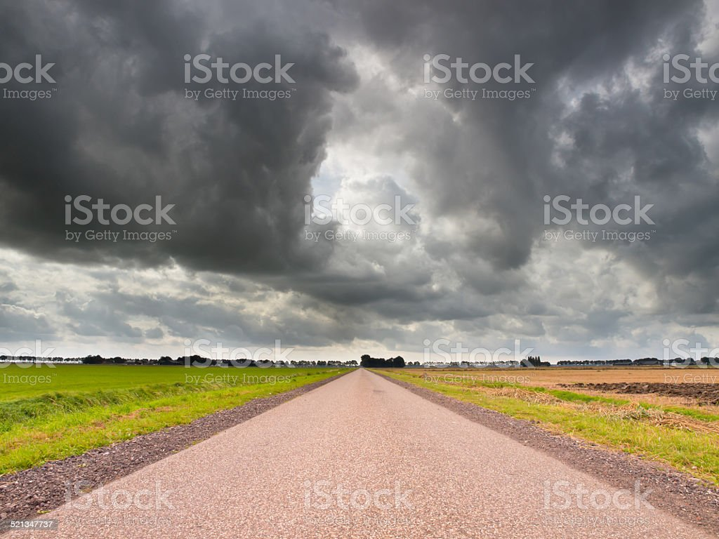 Straight Road under Brooding Sky stock photo
