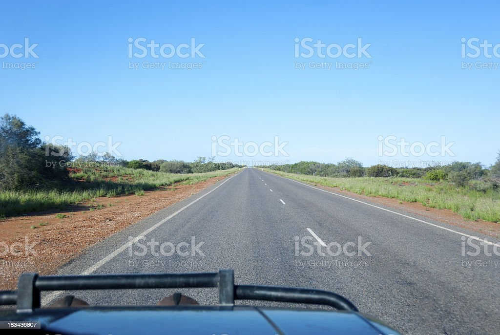 Straight road viewed from inside of 4WD stock photo