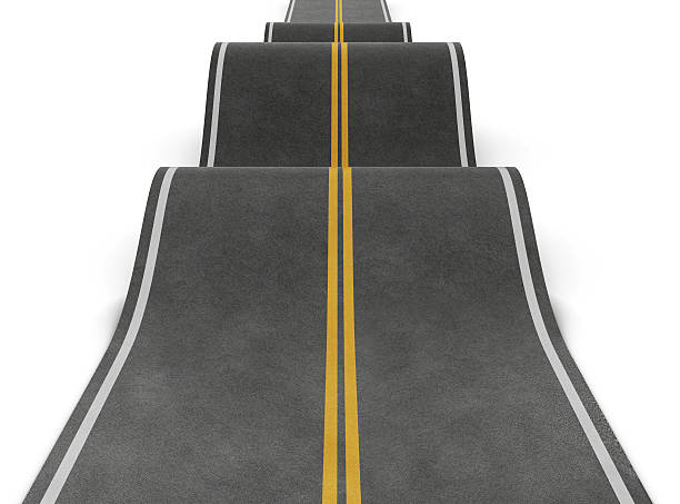 Straight road with irregularities. Bumpy road with ups and downs stock photo