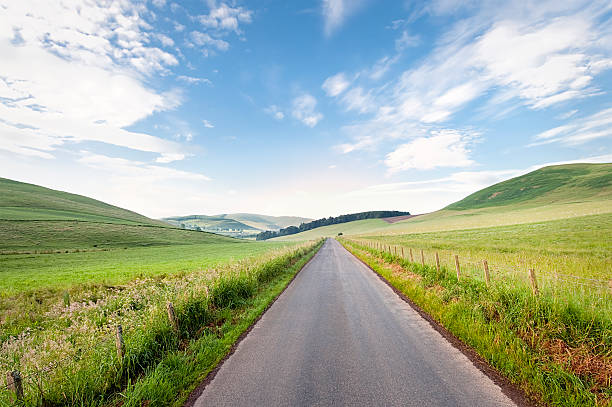 straight scottish country road - straight stock photos and pictures