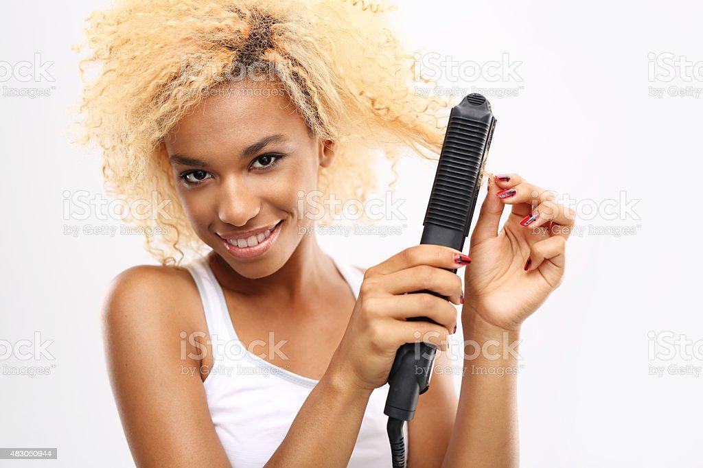 Straighten your hair. stock photo