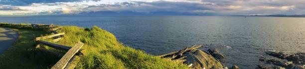 Strait of Juan De Fuca and Distant Olympic Peninsula on The Horizon, Victoria BC Canada Vancouver Island stock photo