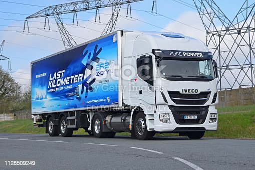 Paris, France - 13rd April, 2018: IVECO Stralis NP400 tractor truck powered by liquid methane (LNG) parked on the road. This model is the most popular LNG truck in Europe.