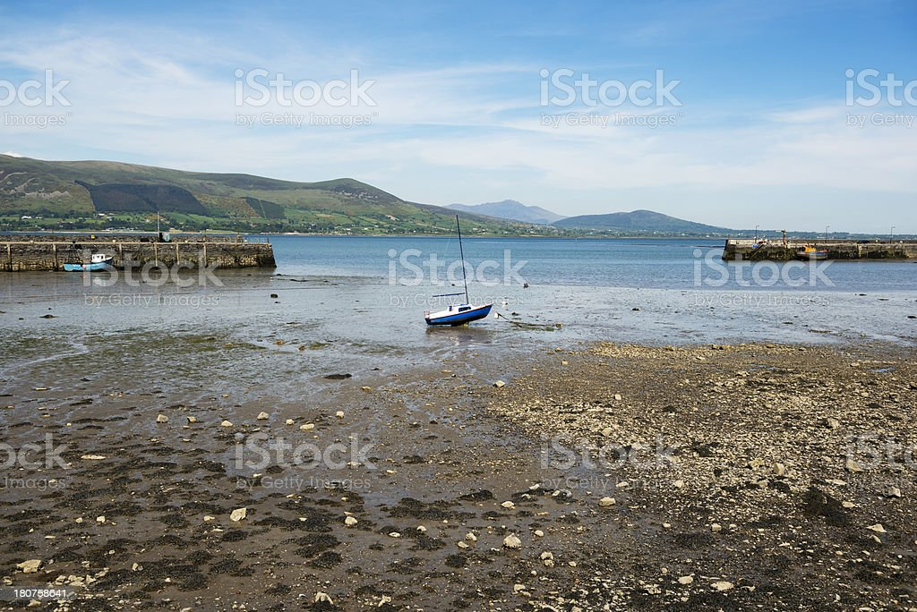 Stranded boat at low tide in Ireland stock photo