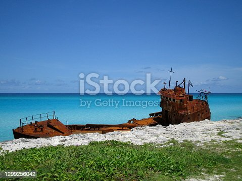 istock Stranded boat wreck - rusty - in heavenly turquoise water - Bahamas 1299256042