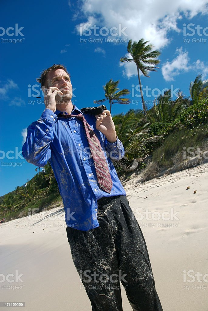 Stranded Businessman Makes a Call royalty-free stock photo