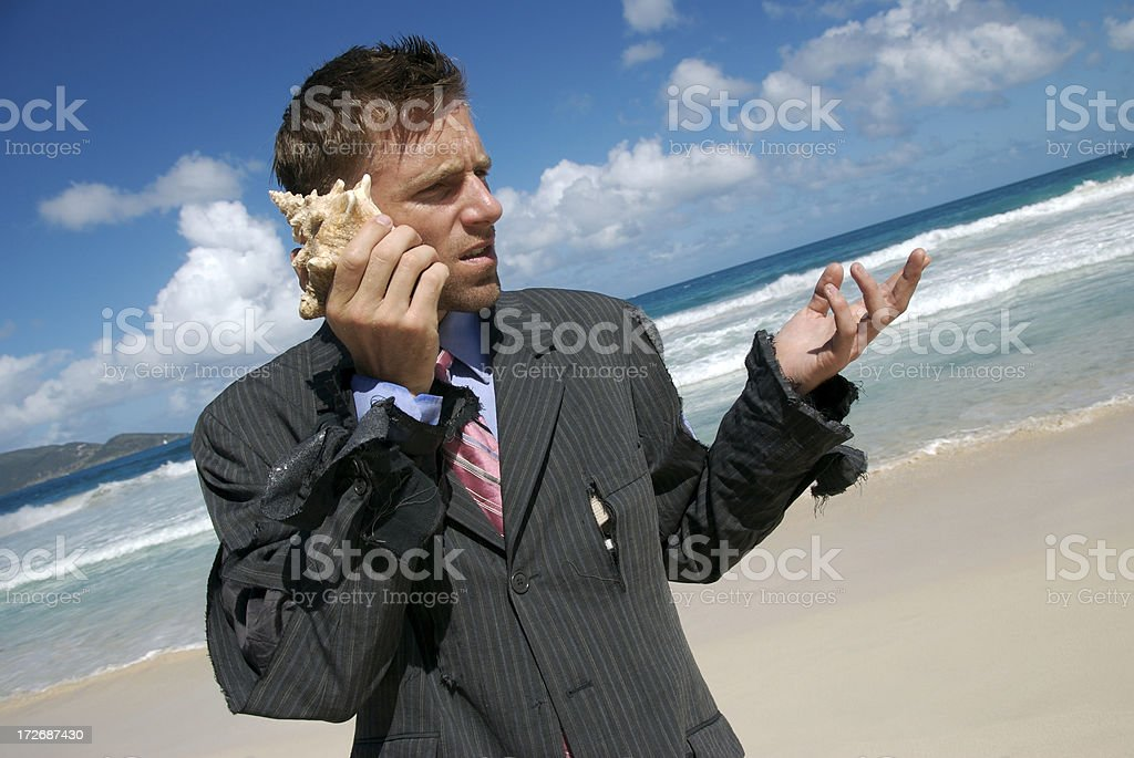 Stranded Businessman Talking on Mobile Shell Phone stock photo