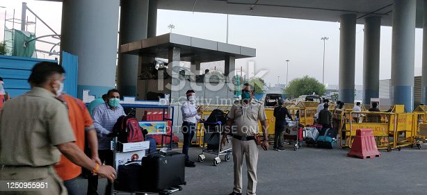 Stranded passengers overseas arriving in Delhi, India with Vande Bharat Mission bu Indian government and Air India amidst corona virus pandemic in Indira Gandhi International Airport in Delhi