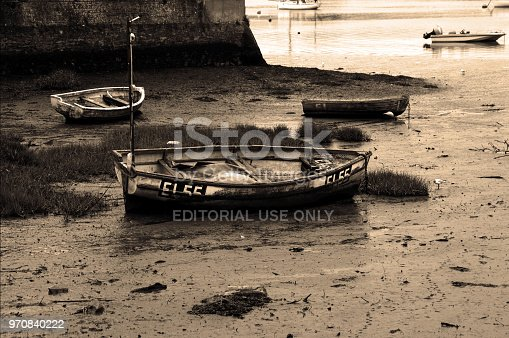 Topsham, Devon, England - July 15th 2015.  Stranded rowing boats in the River Exe near Topsham at Low tide