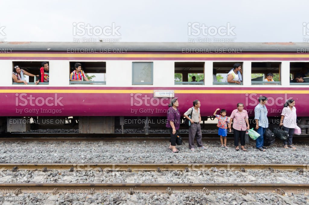 Stranded train passengers in Thailand stock photo