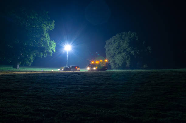 stranded vehicle being rescued at night - stranded stock pictures, royalty-free photos & images