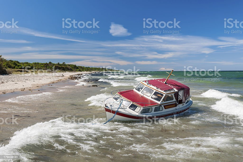 Stranded yacht stock photo