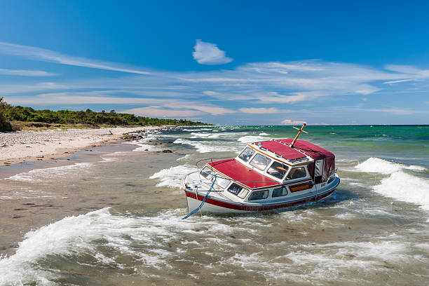 stranded yacht - stranded stock pictures, royalty-free photos & images