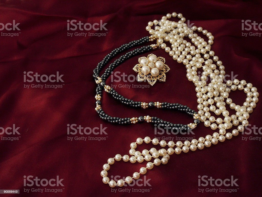 Strands and brooch royalty-free stock photo