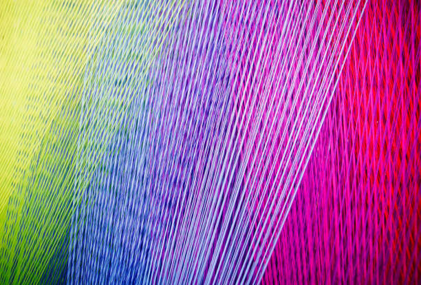 strands of colorful  yarn on a loom - textile stock photos and pictures
