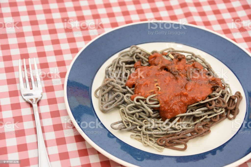 Strange and special concept to eat iron chain like spaghetti stock photo