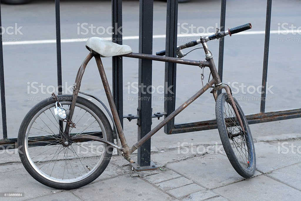 strange  bicycle on moscow street locks to the fence stock photo