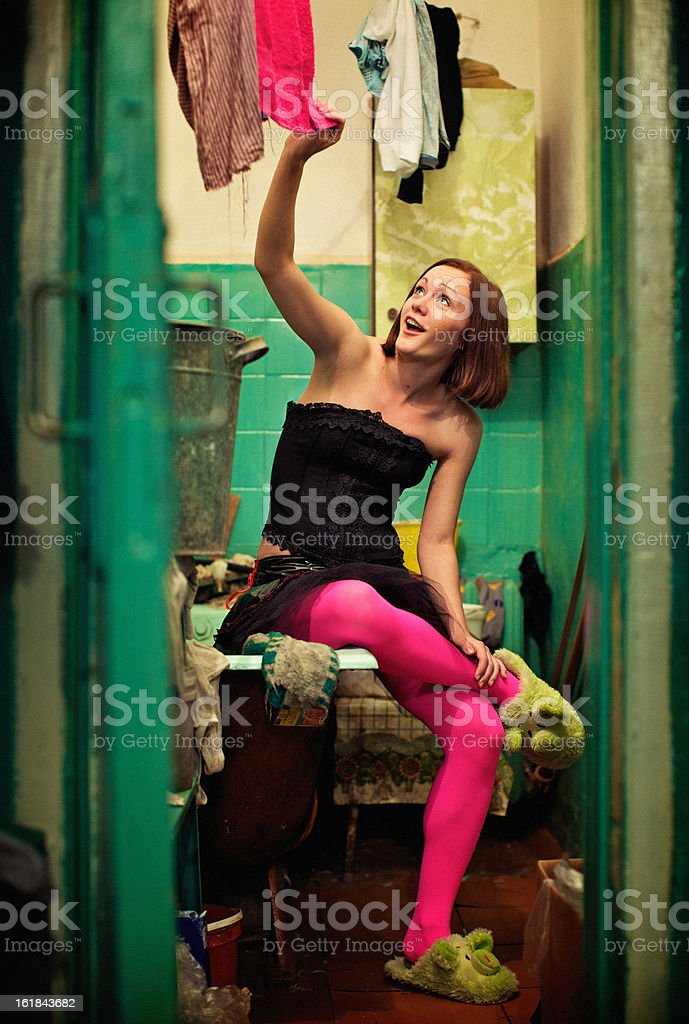 Strange, but very happy girl in pink pantyhose royalty-free stock photo