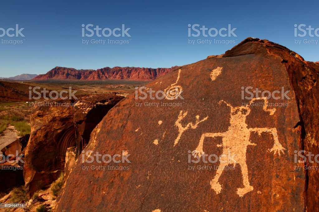 strange characters carved in rock stock photo