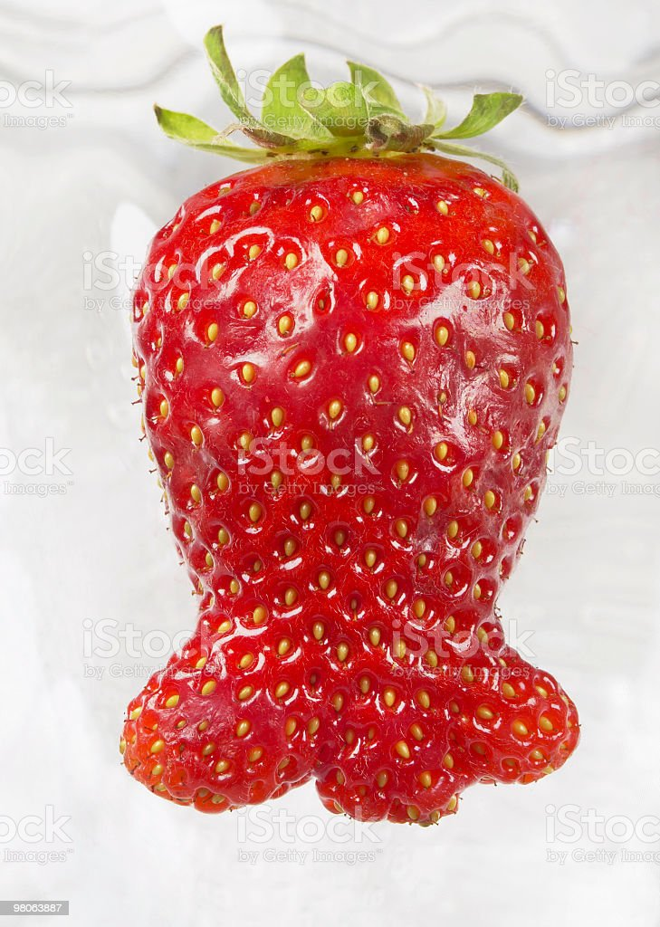 Strange form for strawberry, looking a fish, front view royalty-free stock photo