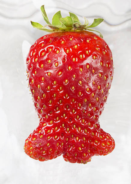 Strange form for strawberry, looking a fish, front view stock photo