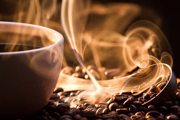 strange golden smoke taking away from coffee seeds - scented stock photos and pictures