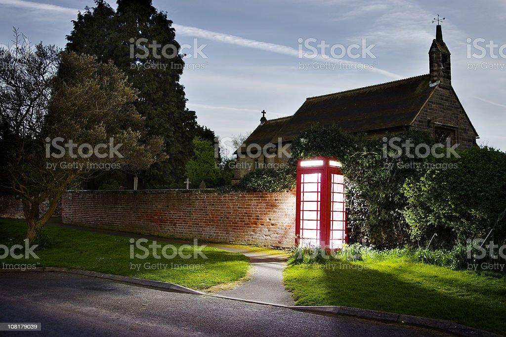 Strange light glowing in English phone box royalty-free stock photo
