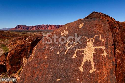 istock strange man carved in stone 873444764