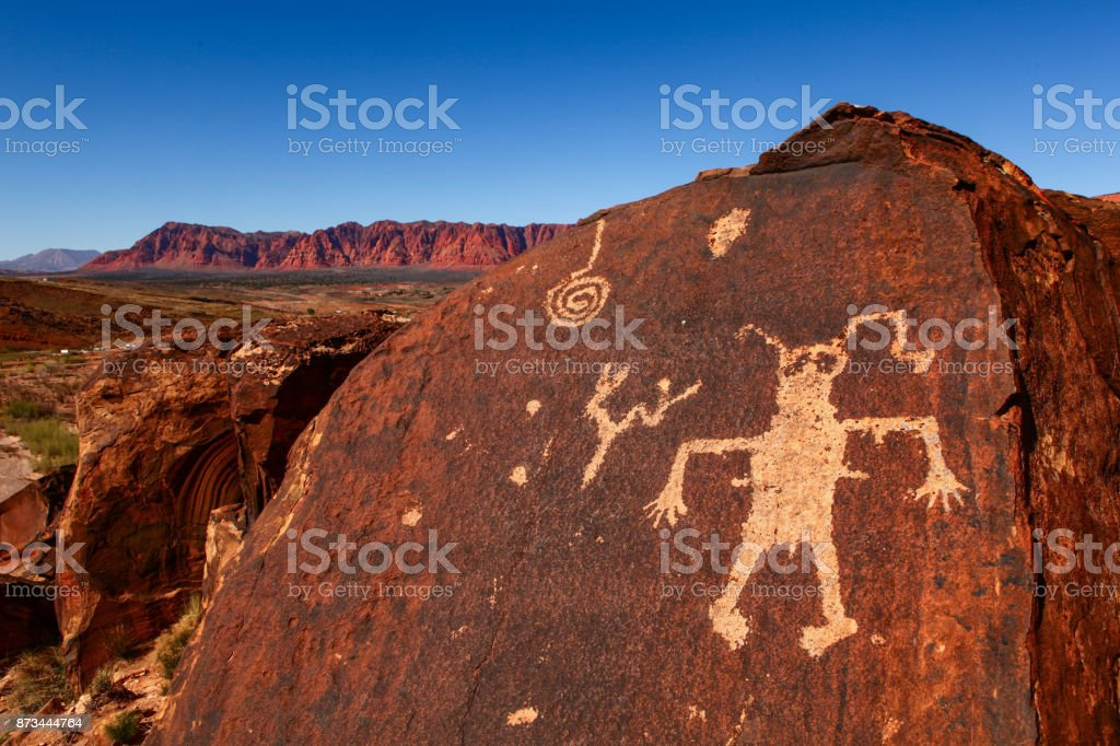 strange man carved in stone stock photo