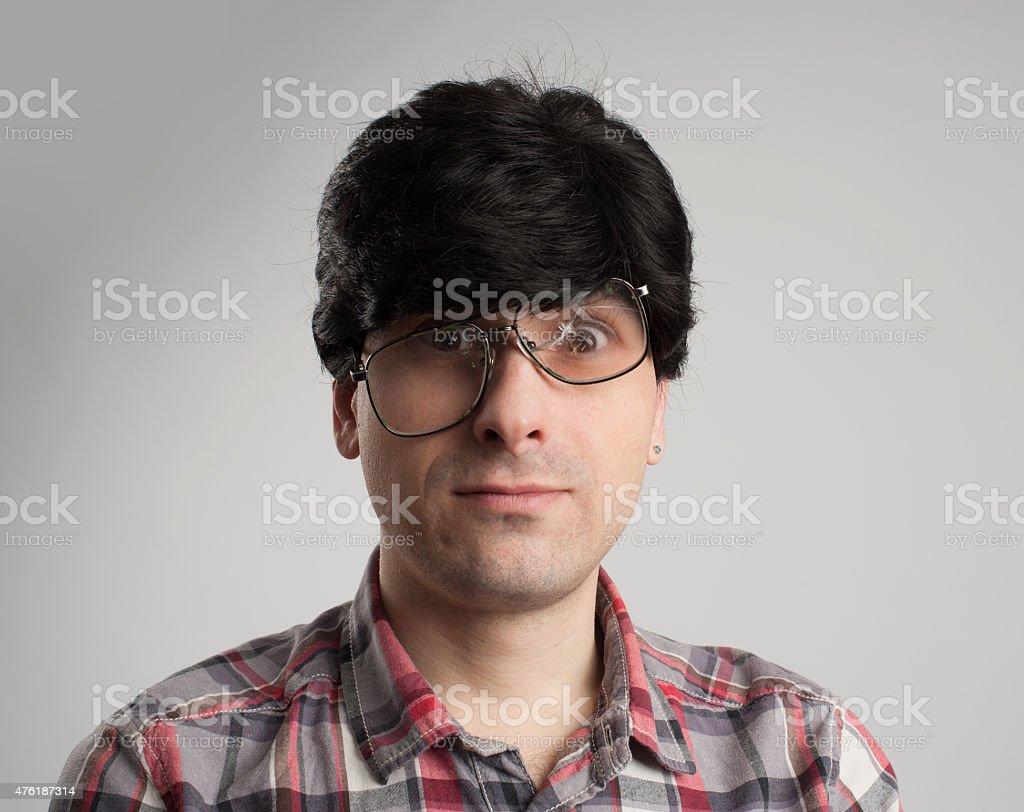 strange man with broken glasses stock photo
