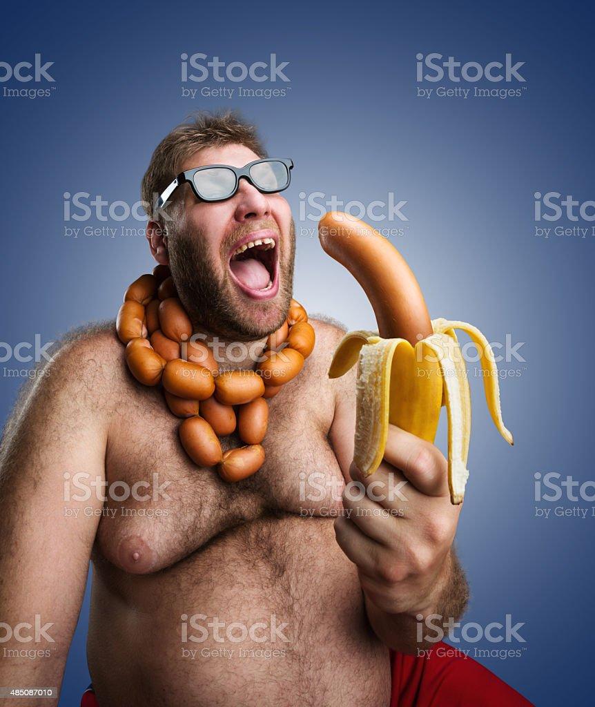 Strange man with sausages stock photo