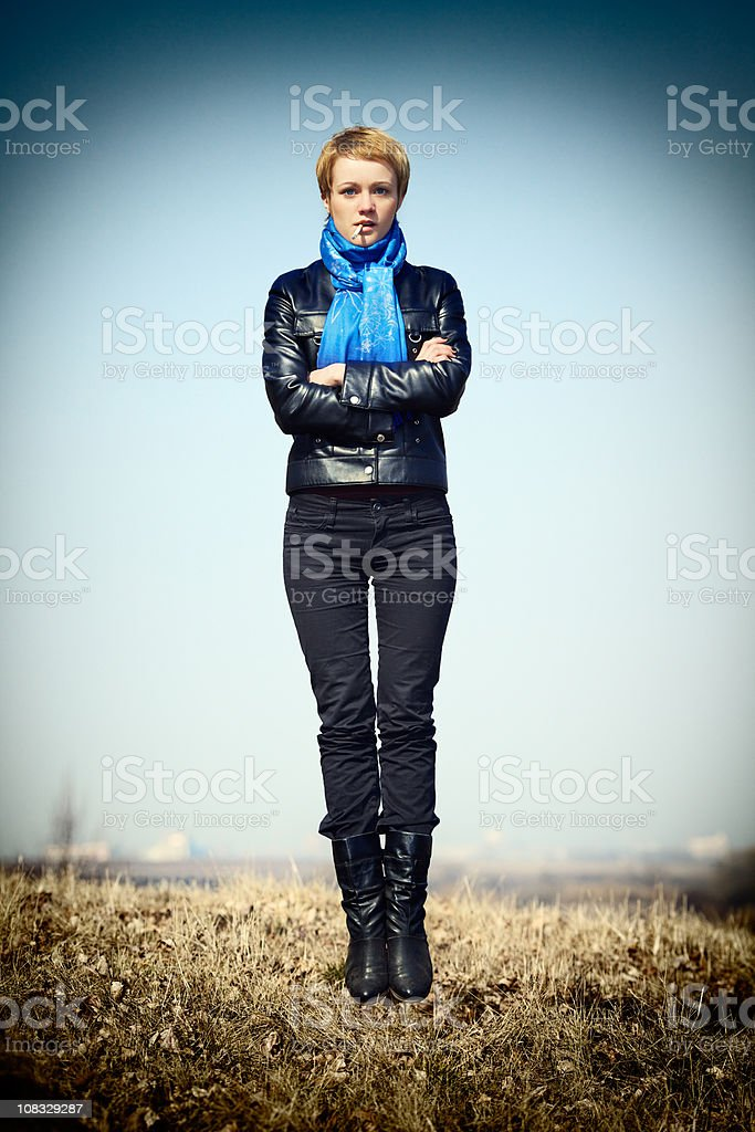 Strange portrait of a girl hanging in the air royalty-free stock photo