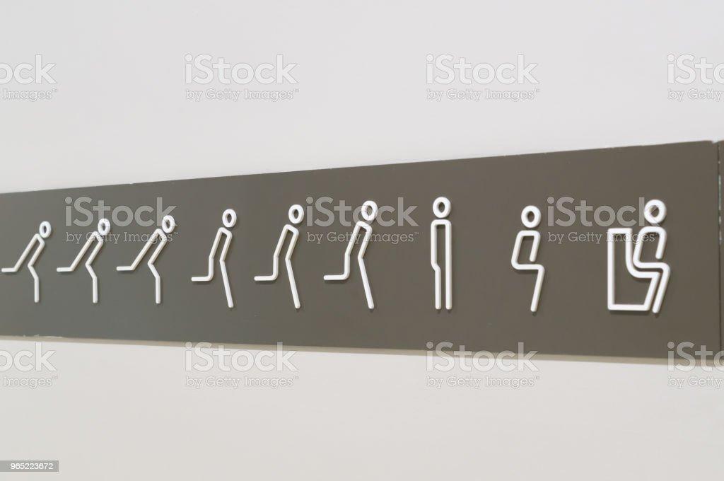 Strange sign on the wall to restroom/toilet zbiór zdjęć royalty-free