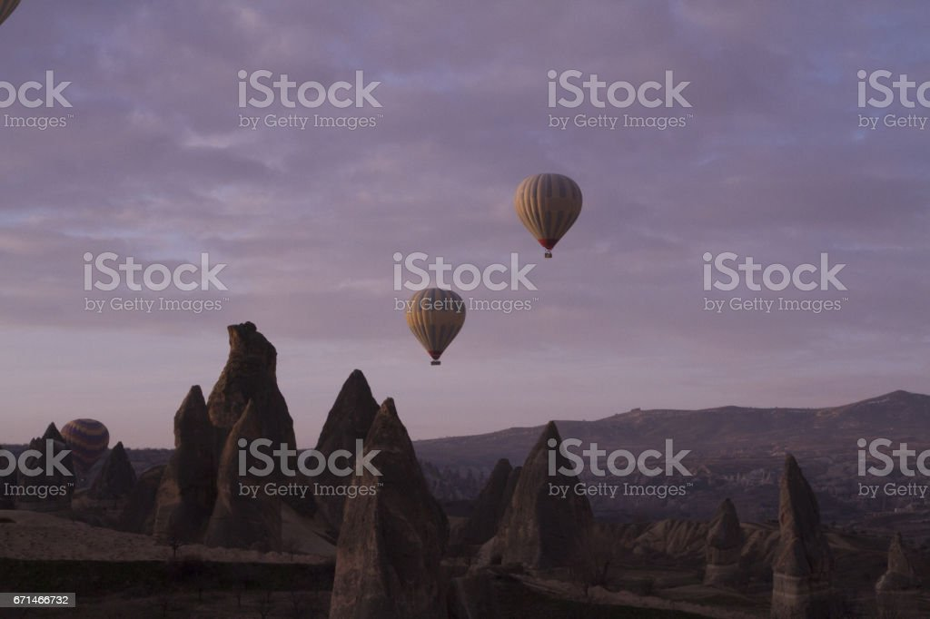Strange stone formations, Cappadocia, Turkey. People during journey to Cappadocia stock photo