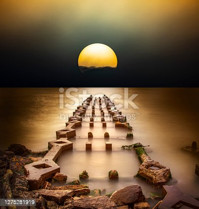 istock Strange sunrise over mysterious ruins of ancient pier structure 1275281919
