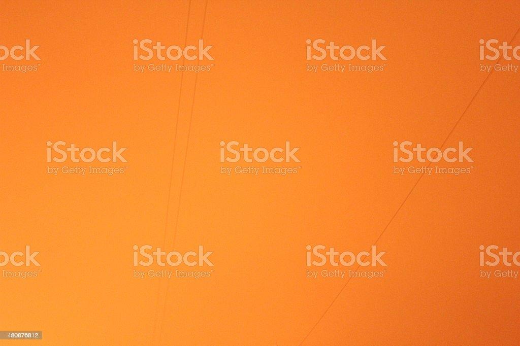 Strange wires in orange sky stock photo