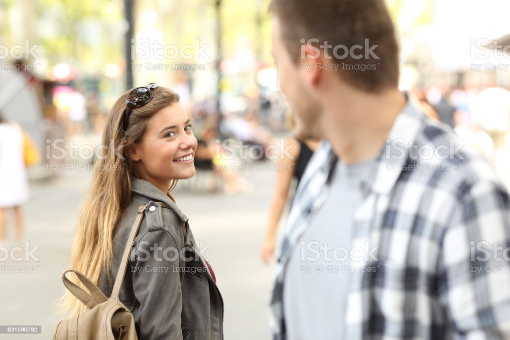 Strangers girl and guy flirting on the street stock photo