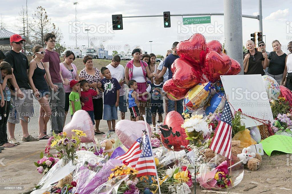 Strangers Hold Hands at Century 16 Victim Memorial stock photo