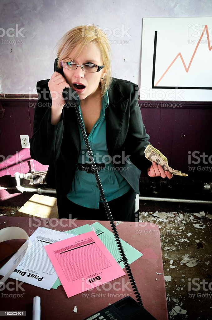 Strapped Business Woman Negotiates with Supplier royalty-free stock photo