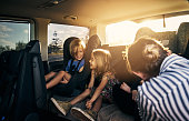 Shot of adorable little children sitting in a car