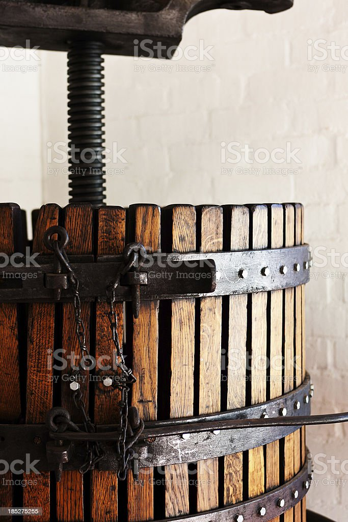 Straps and adjustment mechanism on antique wine press stock photo
