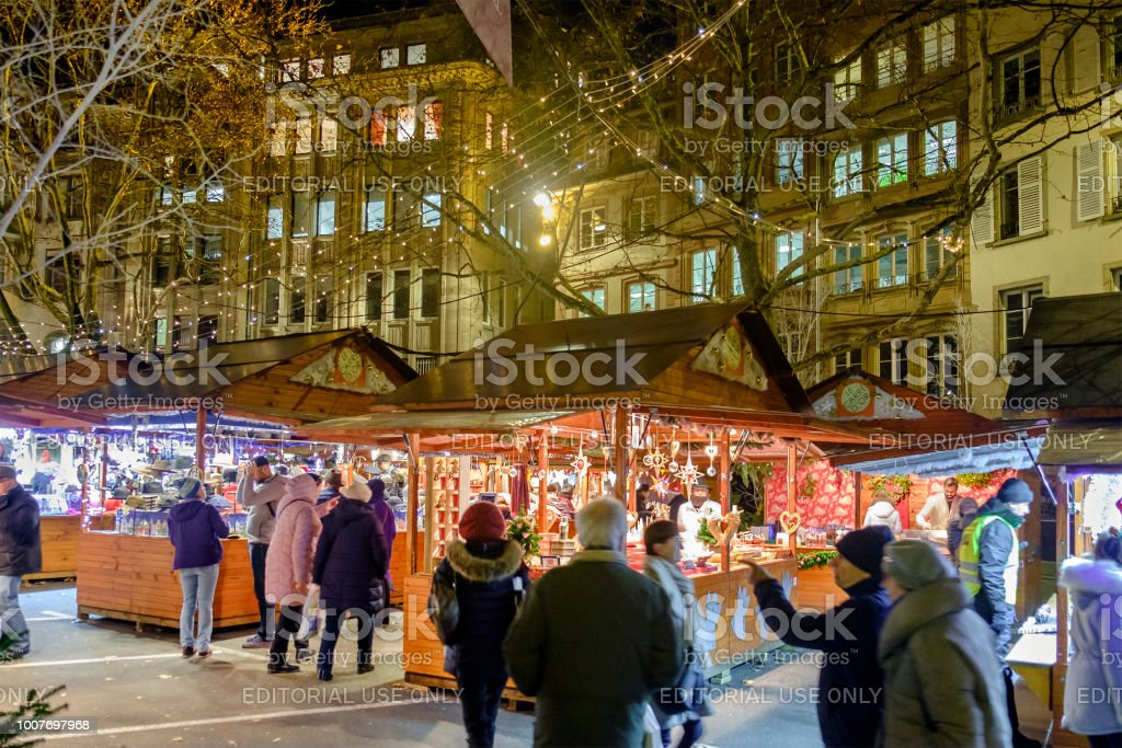 People in the old town of Strasbourg, where every year several...