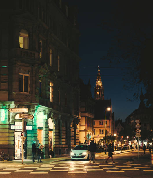 Strasbourg at dusk with cars, pedestrians and romantic street - foto stock