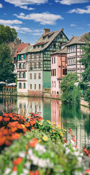 Strasbourg houses near the Quai Petite France with river Strasbourg is the capital city of the Grand Est region, formerly Alsace, in northeastern France. Looking from the Quai de la petite France towards the Quai de la Bruche strasbourg stock pictures, royalty-free photos & images