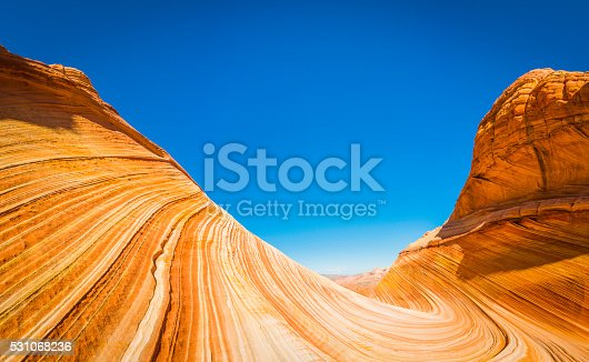 The vibrant swirling strata and iconic curving canyons of The Wave, the landmark rock formation deep in the Paria Canyon-Vermillion Cliffs Wilderness National Monument of Arizona and Utah, Southwest USA. ProPhoto RGB profile for maximum color fidelity and gamut.