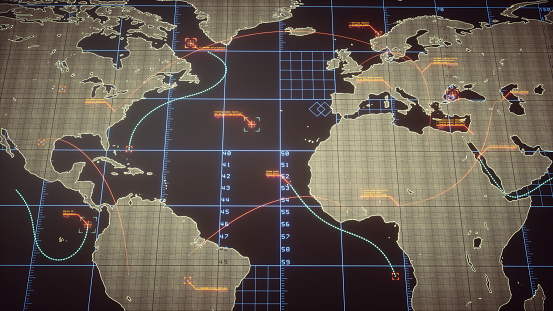 An abstract digital world map containing communication lines and digital infographics. Various objects on the map are being tracked and analyzed.
