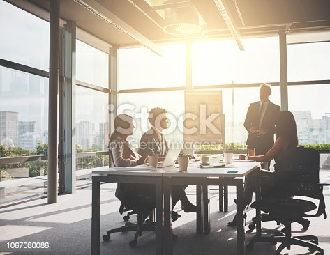 Shot of corporate businesspeople having a meeting in the boardroom